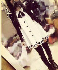 Cute, gyaru: Black cardigan. White sailor dress with black details. Black, high socks. Black shoes.