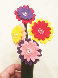 This is a sweet bouquet of four flowers with two sets of petals each to button on. The stems of the flowers are felt wrapped pipe cleaner, so they are sturdy and flexible. The flowers can be taken out Button Flowers, Felt Flowers, Different Colors Of Red, How To Make Buttons, Purple, Pink, Bouquet, Christmas Tree, Crafts