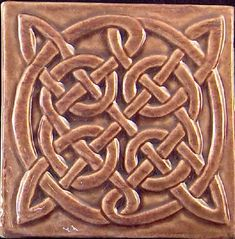 Earthsong Celtic Tiles are gorgeous.  They have a wide selection of custom carved tiles and placques.