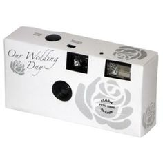 I think it would be awesome to leave a few disposable cameras on every table and let your guests take some pictures and develop them all after!!