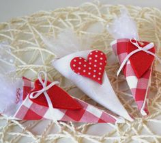 Favor fabric cones with felt heart decorations / wedding favors / baby shower favors / valentine's day / christmas decorations / set of 3. €13.00, via Etsy.
