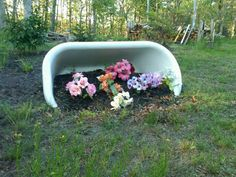i want a bathtub tipped over in my yard, filled with flowers...