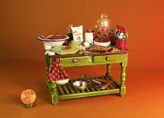 """Dollhouse Miniature Christmas Table  by *veronabarrella.  All pieces are handcrafted by the artist.  Measures 4"""" long - table  has been aged for a vintage look."""
