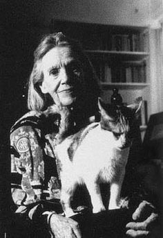 Elena Garro and her kitty looking very wise.