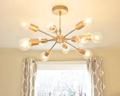Juno: The American booster which launched Americas first satellite, Explorer 1, in 1958. The Juno Chandelier combines organic design and mid-century modern Sputnik style. Ideal for small to mid-sized rooms with 8 foot ceilings, this piece is sure to be a conversation piece in any