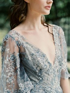 Sparkling Dusty Blue Wedding Dress with Flutter Sleeves | Laura Gordon Photography | http://heyweddinglady.com/modern-war-and-peace-wedding-inspiration-blue-silver/