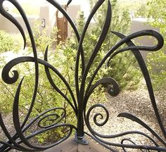 Francis Nowicki     I guess this is actually a railing and not a gate but it certainly is unusual and beautiful!