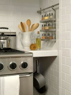 I like the idea of hanging the pan under the counter.  Great idea for that space instead of a thin cabinet.