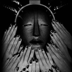 Man Ray - 1932, Elizabeth Arden Electrotherapy Facial Mask. Advertising shoot.