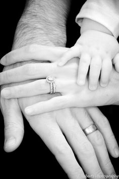 love this. husband, wife, child. love how the two hands are top are slightly gripping the hand under it. so sweet.