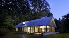 The home is clad in galvalume, a low-maintenance, zinc-coated metal, to make upkeep easier. Prefabricated, 10- to 12-inch-thick panels in the roof provide insulation, and the low walls are packed with limestone. Courtesy of: Tony Soluri
