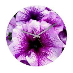 "#Petunias Wall #Clock  Beautiful purple Petunia flowers     Made of eco-friendly hardboard with gloss-finish face     Elegant, exposed clock hands     16"" diameter $57.49 #homedecor"
