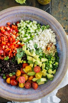 Black Bean Quinoa Salad with Lime Vinaigrette. This hearty salad is filled with healthy veggies and makes a great weekday lunch!