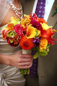{Vibrant Jewel Tone Bridal Florals: Large Yellow Calla Lilies, Yellow Roses, Yellow Orchids, Orange Dahlias, Orange Calla Lilies, Sangria Chrysanthemums, Hot Pink Roses, Hot Pink/Chartreuse Gloriosa Lilies, Green Cymbidium Orchids & Purple Florals}