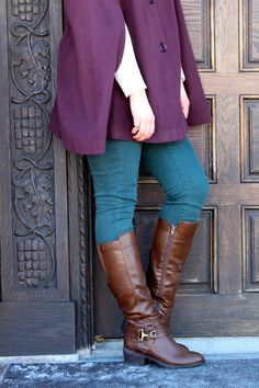 brown riding boots and teal jeans