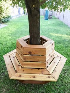 What a great idea! Hexagon cedar bench around a tree (or make it a cooler inside for drinks!)