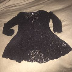 FREE PEOPLE TOP Beautiful lace detail. No holes. Perfect condition. 3/4 length sleeves. Fitted top with a fanned out bottom. Such a pretty top and perfect for the holidays! Has a stretch Free People Tops Blouses