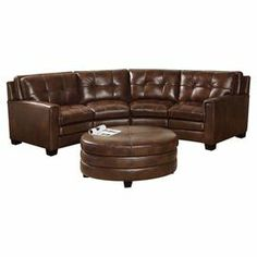 """Bring stately appeal to your living room or den with this leather sofa and ottoman set, featuring a solid wood frame and button-tufted accents.  Product: Sofa and ottomanConstruction Material: Top grain leather, high density foam and kiln-dried woodColor: Chestnut brownFeatures:  Button-tuftedHand-stitched detailsCorner-blocked joinery Dimensions: Sofa: 37"""" H x 147"""" W x 39"""" DOttoman: 19"""" H x 41"""" Diameter"""