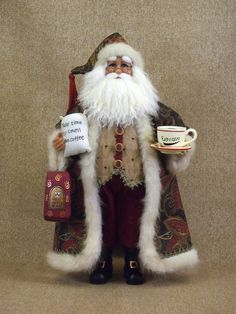Features:  -Christmas collection.  -High quality item with hand painted face and hands, glass inset eyes and real mohair beard.  -Exquisite fabrics and accessories.  -Jovial saying on coffee bean bag.