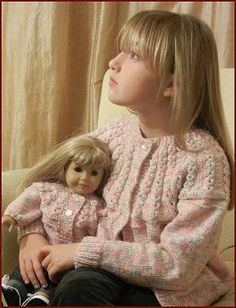 Free knitting pattern for a girl's cardigan with an eyelet yoke, comes with matching American Girl doll cardigan pattern.