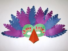 bird mask I made with construction paper, glued onto half of a paper plate