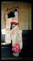 Maiko girl (Geisha apprentice) leaving Japanese Teahouse, Kyoto, Japan