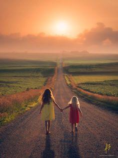 """Using the serene setting of the Nebraskan countryside Jake Olson photographs children in adorable and dreamlike scenarios."""