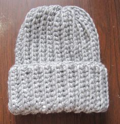 How to make a crochet ribbed hat that looks just like knit! This easy free pattern works up fast and makes a great beginner project.