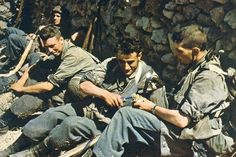 German paratroopers during a break in battle on Crete, May 1941. Certainly a propaganda photo for the homeland, concealing the huge losses o...