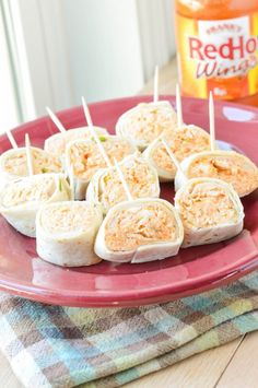 These buffalo chicken tortilla roll-ups are a super easy appetizer and a definite crowd pleaser!
