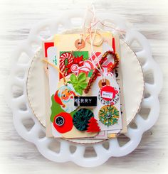 Get ready for your December page projects with this charming Holiday themed embellishment kit!
