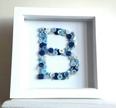 Hey, I found this really awesome Etsy listing at https://www.etsy.com/uk/listing/469493586/letter-button-art-frame-initial-button