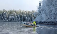 A fisherman heading out for seine fishing on Lake Miekojärvi in Pello in Lapland