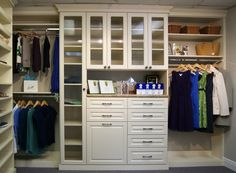Bon A Custom Closet Completed In An Almond, Raised Panel Finish. Can Be Seen In  The SpaceMan Home Office Showroom.