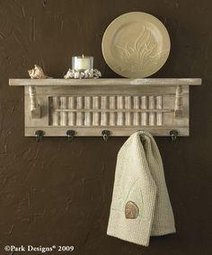 Small classic shutter painted and made into a shelf complete with hooks!  Great for the kitchen or nook area.