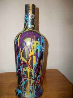 painted bottle abstract with wire heart