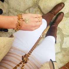 White pants and dark brown boots are an every closet must-have!   cc: @kathrynbyers