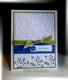 Embossed top half, pattern paper bottom half, a ribbon and a greeting. Haven't seen such an elegant and simple layout for a long time.
