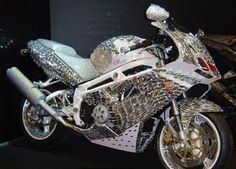 The billionaire Saudi prince Al Waleed Bin Talal owns an exclusive handmade diamond Ducati motorcycle, with cost estimated at about four point eight million dollars. Specially ordered by the royal prince, the majestic bike is not crafted entirely from diamonds but partially from Swarovski crystals, still it looks an absolute sparkling beauty.