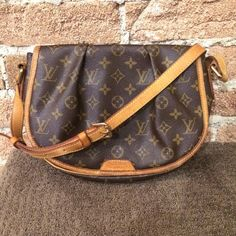Authentic Louis Vuitton Menilmontant Crossbody The custest crossbody! So classy and a super sought after bag! The monogram canvas is so classy and super luxurious! Adds a bit of luxury to every outfit. Bag is in great condition overall. Super clean inside and outside! Lots of nifty little pockets. One of the straps has a few pulled stiches at the base, please see pictures. Please feel free to ask questions or make an offer! :) Louis Vuitton Bags Crossbody Bags
