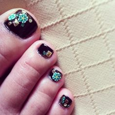 "3D Nail Art Toes.  Used Wet n Wild Fastdry ""Ebony Hates Chris"" for the base coat.  In the corner of each nail where nail art was going to be placed, I painted a wedge of gold using Sinful Colors ""All About You.""  3D art is a combination of Fimo flowers, metal studs, and crystals. #nailart"