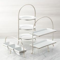 Made of sturdy iron with a nickel-plated finish, this three-tier stand provides a space-saving solution to stacking dinner plates or displaying buffet items. Plates not included. Cool Kitchen Gadgets, Kitchen Items, Cool Kitchens, Kitchen Decor, Kitchen Design, 3 Tier Stand, Tiered Stand, Dish Display, Kitchen Collection