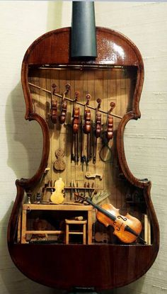 This violin makers shop by W. Foster Tracy, is a miniature built inside a full-size violin. It was on display at the Mini Time Machine Museum of Miniatures, Tucson, Arizona. All completed instruments and tools are fully functional in this model. Tiny Violin, Violin Art, Violin Painting, Violin Music, Violin Shop, Violin Makers, Vitrine Miniature, Miniature Rooms, Miniature Houses