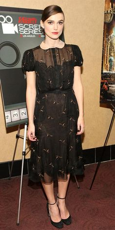 Keira Knightley screened Anna Karenina in an embroidered Valentino dress, diamond studs and suede heels.