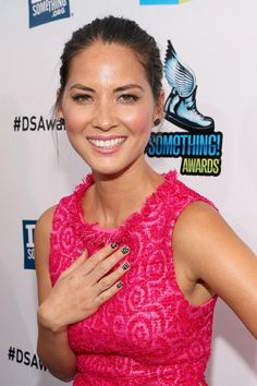 Black/white polk a dot nail on magenta (Olivia Munn).