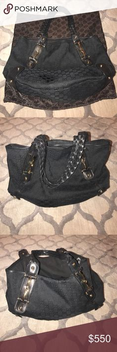"""Gucci purse, black canvas, leather braided straps 100% Authentic Gucci Purse, black Canvas with signature G print, gold hardware, with horse-bit style buckles detail. Also has a signature leather braided straps. Comes with duster as shown. Perfect everyday Bag! Bad measure approx 14"""" wide by 12"""" height and 5"""" deep across the bottom. Has a  snapable leather strap inside the bag. (See photos). Has had some minor wear damage. (See photos). (Mainly rubbing of fabric in some places.) Price…"""