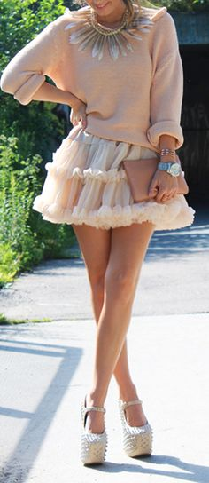 Love the statement feather necklace and the poofy skirt and blush palette of this outfit.