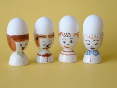 4 Egg Cups 1950s Family / advertising for Michigan Eggs in original box made in Japan. via Etsy.
