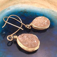 Blush Druzy Earrings Tear drop Druzy in blush on a 14k gold filled hooks wire wrapped in a 14k gold filled wire. These are contemporary and very much instyle. Dress it up or down. Approximate length 1.9 inches. Matana Jewelry Earrings