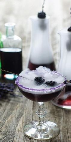 Mr. Hyde Potion Cocktail! Top this spirited concoction (with the most refreshing tarragon simple syrup base!) with dry ice for a truly spooky effect.